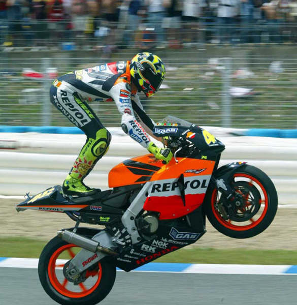 http://dk8000.files.wordpress.com/2011/05/rossi-hrc-stand-wheelie.jpg